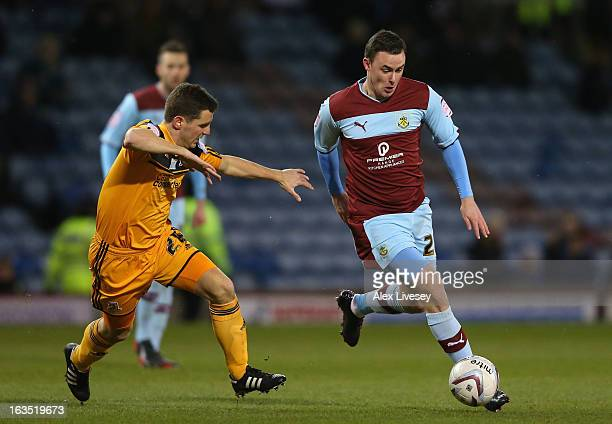 Keith Treacy of Burnley runs at Alex Bruce of Hull City during the npower Championship match between Burnley and Hull City at Turf Moor on March 11...