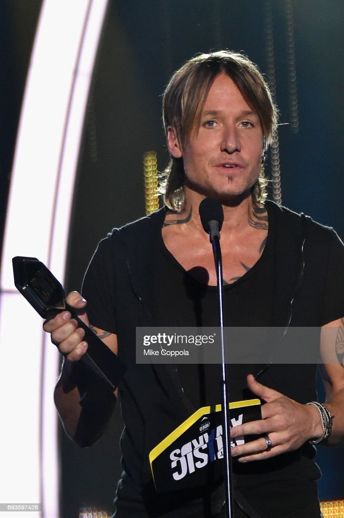 Keith Urban accepts Best Male Video of the Year award onstage during the 2017 CMT Music Awards at the Music City Center on June 6, 2017 in Nashville, Tennessee.