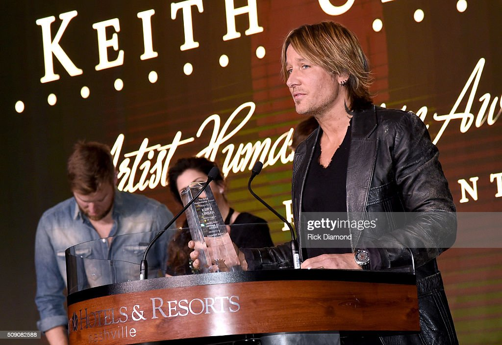 <a gi-track='captionPersonalityLinkClicked' href=/galleries/search?phrase=Keith+Urban&family=editorial&specificpeople=202997 ng-click='$event.stopPropagation()'>Keith Urban</a> accepts the Artist Humanitarian Award during the CRS 2016 at Omni Hotel on February 8, 2016 in Nashville, Tennessee.