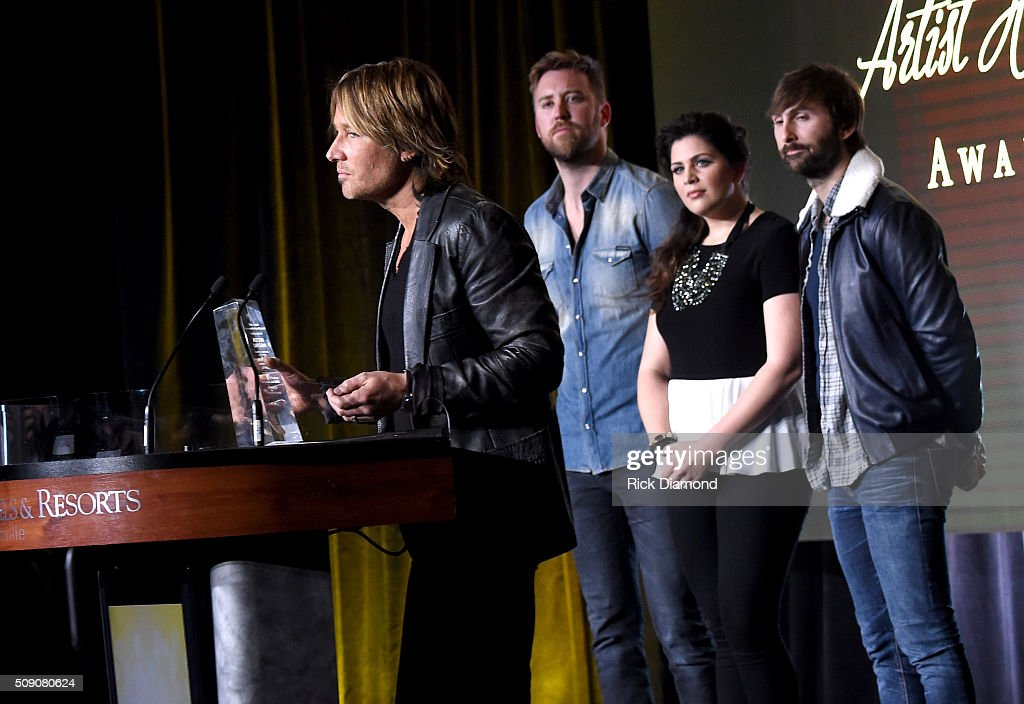 <a gi-track='captionPersonalityLinkClicked' href=/galleries/search?phrase=Keith+Urban&family=editorial&specificpeople=202997 ng-click='$event.stopPropagation()'>Keith Urban</a> (L) accepts the Artist Humanitarian Award from <a gi-track='captionPersonalityLinkClicked' href=/galleries/search?phrase=Charles+Kelley&family=editorial&specificpeople=3935435 ng-click='$event.stopPropagation()'>Charles Kelley</a>, <a gi-track='captionPersonalityLinkClicked' href=/galleries/search?phrase=Hillary+Scott+-+Singer&family=editorial&specificpeople=7335332 ng-click='$event.stopPropagation()'>Hillary Scott</a>, and <a gi-track='captionPersonalityLinkClicked' href=/galleries/search?phrase=Dave+Haywood&family=editorial&specificpeople=4620526 ng-click='$event.stopPropagation()'>Dave Haywood</a> during the CRS 2016 at Omni Hotel on February 8, 2016 in Nashville, Tennessee.