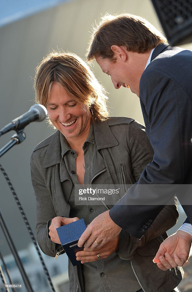 <a gi-track='captionPersonalityLinkClicked' href=/galleries/search?phrase=Keith+Urban&family=editorial&specificpeople=202997 ng-click='$event.stopPropagation()'>Keith Urban</a> and BMI's Clay Bradley attend as <a gi-track='captionPersonalityLinkClicked' href=/galleries/search?phrase=Keith+Urban&family=editorial&specificpeople=202997 ng-click='$event.stopPropagation()'>Keith Urban</a>, BMI & ASCAP Celebrate the No. 1 Song 'Little Bit Of Everything' at Aerial In Nashville on October 7, 2013 in Nashville, United States.