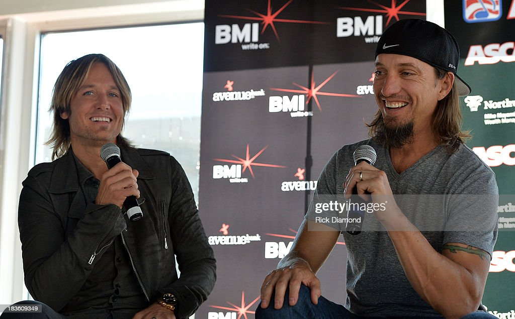 Keith Urban and co-writer Brad Warren talk with the press as Keith Urban, BMI & ASCAP Celebrate the No. 1 Song 'Little Bit Of Everything' at Aerial In Nashville on October 7, 2013 in Nashville, United States.