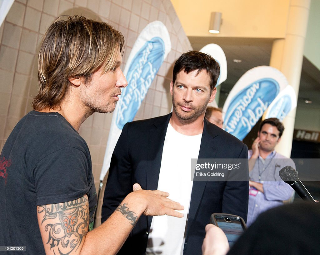 Keith Urban and Harry Connick, Jr. are interviewed by press as they arrive at the Ernest N. Morial Convention Center on August 27, 2014 in New Orleans, Louisiana.