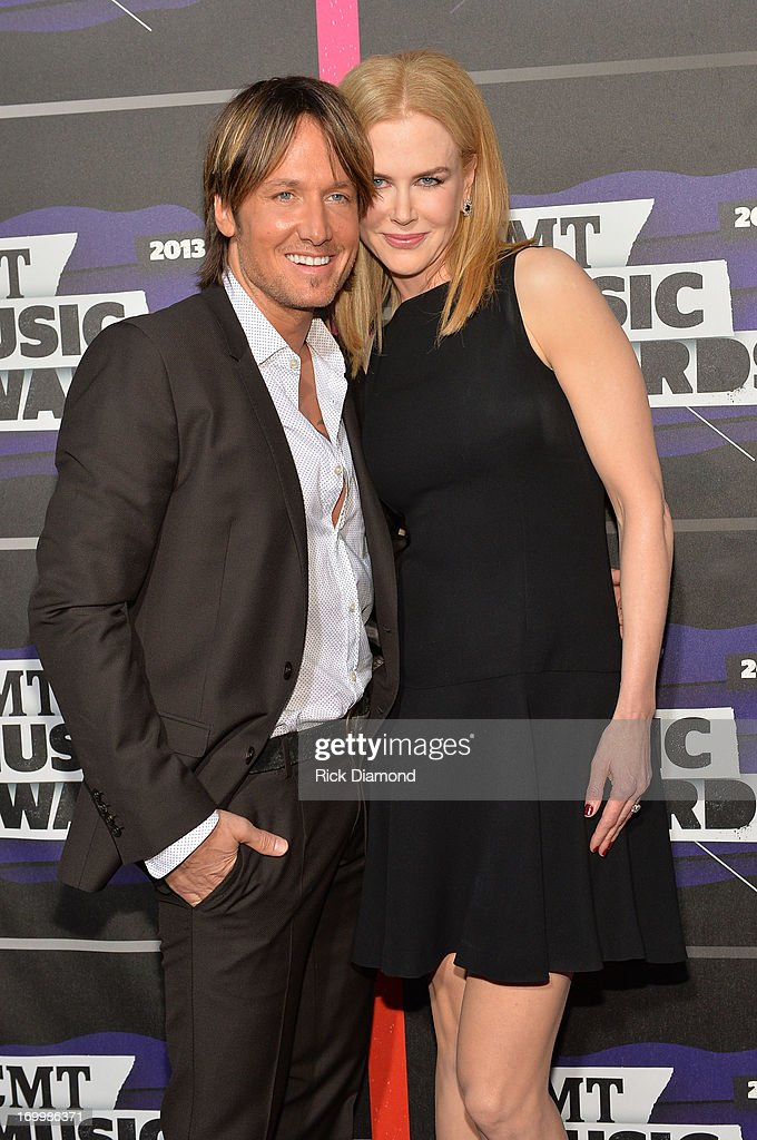 <a gi-track='captionPersonalityLinkClicked' href=/galleries/search?phrase=Keith+Urban&family=editorial&specificpeople=202997 ng-click='$event.stopPropagation()'>Keith Urban</a> and <a gi-track='captionPersonalityLinkClicked' href=/galleries/search?phrase=Nicole+Kidman&family=editorial&specificpeople=156404 ng-click='$event.stopPropagation()'>Nicole Kidman</a> attend the 2013 CMT Music awards at the Bridgestone Arena on June 5, 2013 in Nashville, Tennessee.