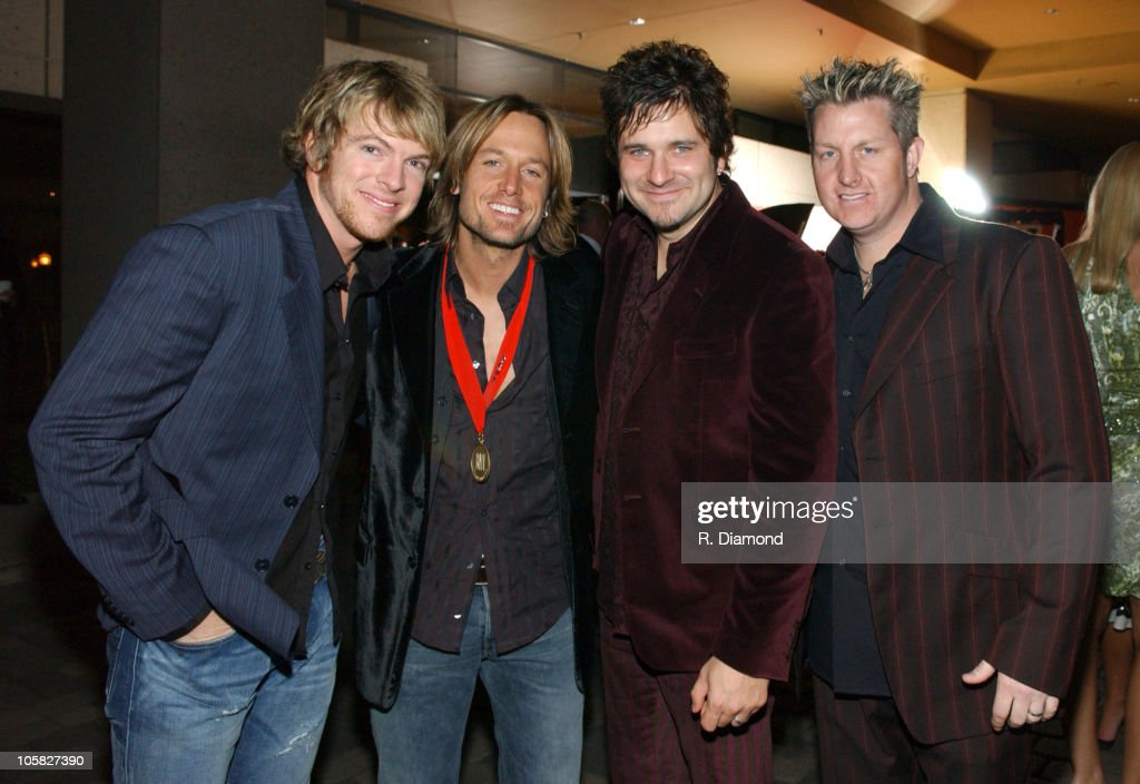 Keith Urban (second from left) and Rascal Flatts during 52nd Annual BMI Country Awards - Arrivals at BMI in Nashville, Tennessee, United States.