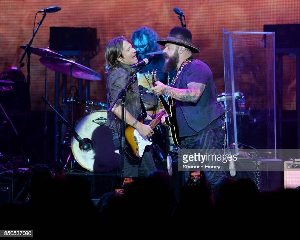Keith Urban and Zac Brown perform at the VetsAid Charity Benefit Concert at Eagle Bank Arena on September 20 2017 in Fairfax Virginia