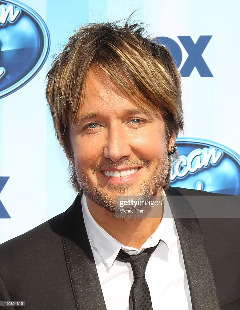 <a gi-track='captionPersonalityLinkClicked' href=/galleries/search?phrase=Keith+Urban&family=editorial&specificpeople=202997 ng-click='$event.stopPropagation()'>Keith Urban</a> arrives at Fox's 'American Idol' XIII Finale held at Nokia Theatre L.A. Live on May 21, 2014 in Los Angeles, California.