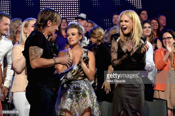 Keith Urban Carrie Underwood and Nicole Kidman attend the 2017 CMT Music Awards at the Music City Center on June 6 2017 in Nashville Tennessee