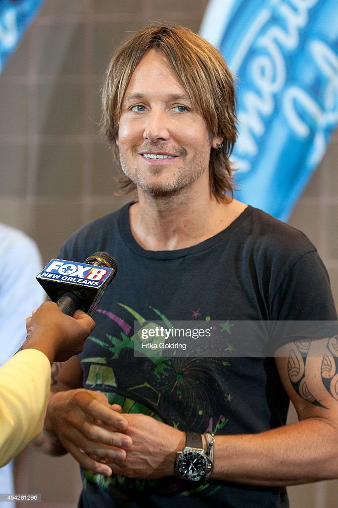 <a gi-track='captionPersonalityLinkClicked' href=/galleries/search?phrase=Keith+Urban&family=editorial&specificpeople=202997 ng-click='$event.stopPropagation()'>Keith Urban</a> is interviewed by press as he arrives at the Ernest N. Morial Convention Center on August 27, 2014 in New Orleans, Louisiana.