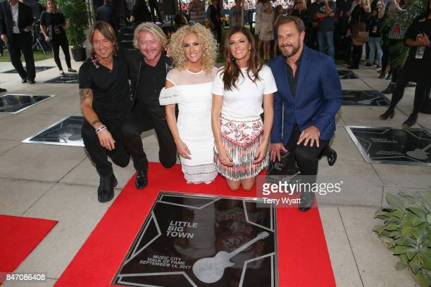 Keith Urban joins Honorees Philip Sweet Kimberly Schlapman Karen Fairchild and Jimi Westbrook of Little Big Town during the Nashville Music City Walk...