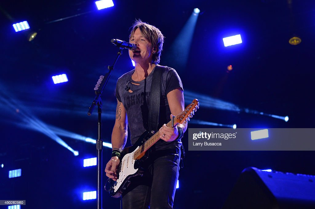 <a gi-track='captionPersonalityLinkClicked' href=/galleries/search?phrase=Keith+Urban&family=editorial&specificpeople=202997 ng-click='$event.stopPropagation()'>Keith Urban</a> performs at the 2014 CMA Festival on June 7, 2014 in Nashville, Tennessee.