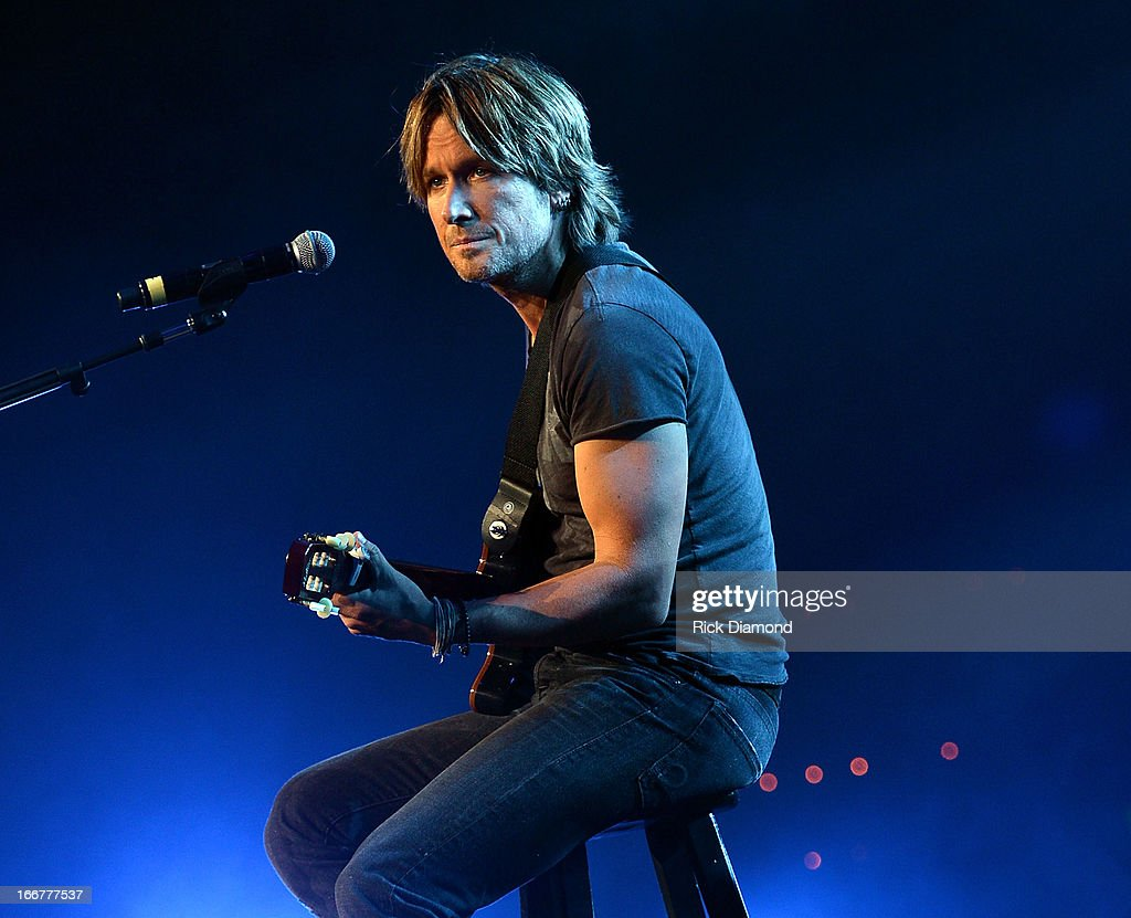 <a gi-track='captionPersonalityLinkClicked' href=/galleries/search?phrase=Keith+Urban&family=editorial&specificpeople=202997 ng-click='$event.stopPropagation()'>Keith Urban</a> performs during <a gi-track='captionPersonalityLinkClicked' href=/galleries/search?phrase=Keith+Urban&family=editorial&specificpeople=202997 ng-click='$event.stopPropagation()'>Keith Urban</a>'s Fourth annual We're All For The Hall benefit concert at Bridgestone Arena on April 16, 2013 in Nashville, Tennessee.