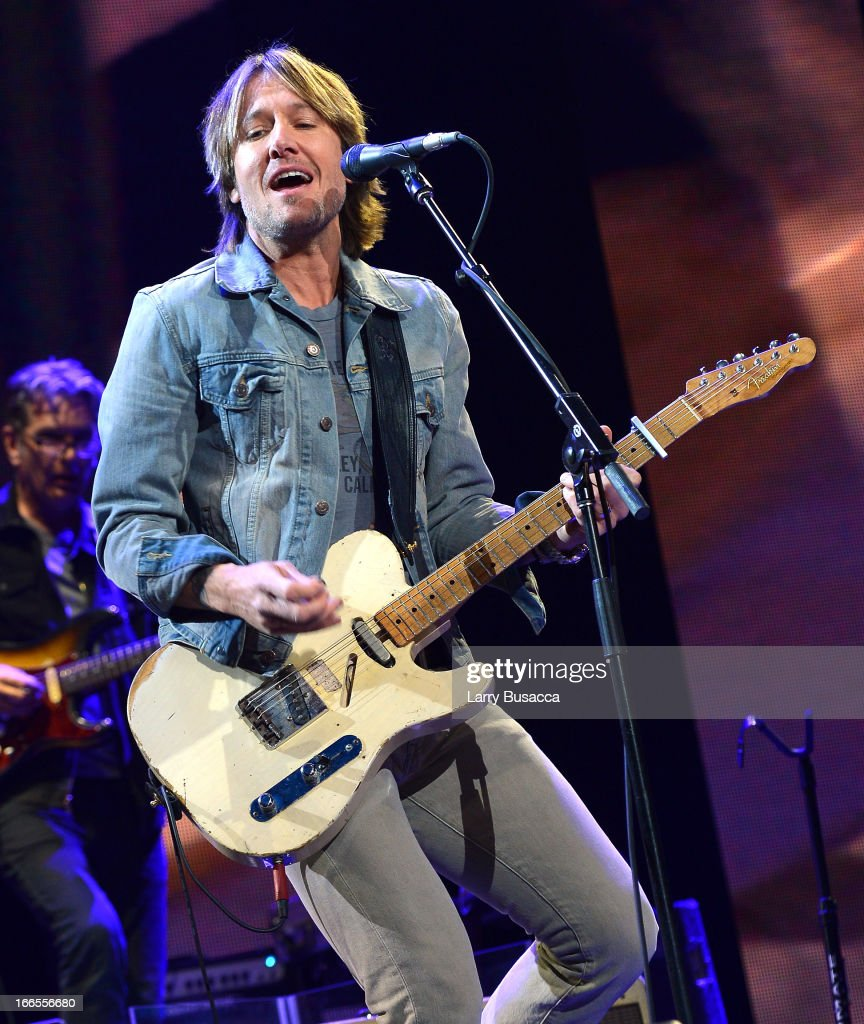 <a gi-track='captionPersonalityLinkClicked' href=/galleries/search?phrase=Keith+Urban&family=editorial&specificpeople=202997 ng-click='$event.stopPropagation()'>Keith Urban</a> performs on stage during the 2013 Crossroads Guitar Festival at Madison Square Garden on April 13, 2013 in New York City.