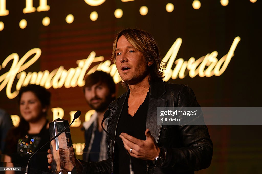 <a gi-track='captionPersonalityLinkClicked' href=/galleries/search?phrase=Keith+Urban&family=editorial&specificpeople=202997 ng-click='$event.stopPropagation()'>Keith Urban</a> receives his Humanitarian Award during the Country Music Seminar at Omni Hotel on February 8, 2016 in Nashville, Tennessee.