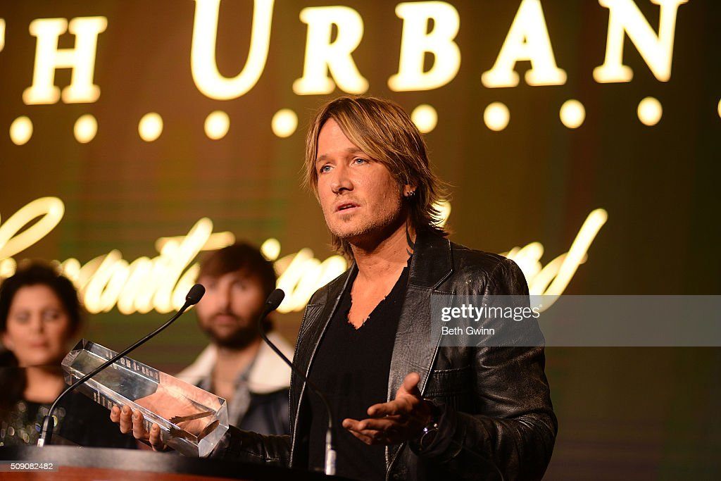 Keith Urban receives the Humanitarian award during the Country Music Seminar at Omni Hotel on February 8, 2016 in Nashville, Tennessee.