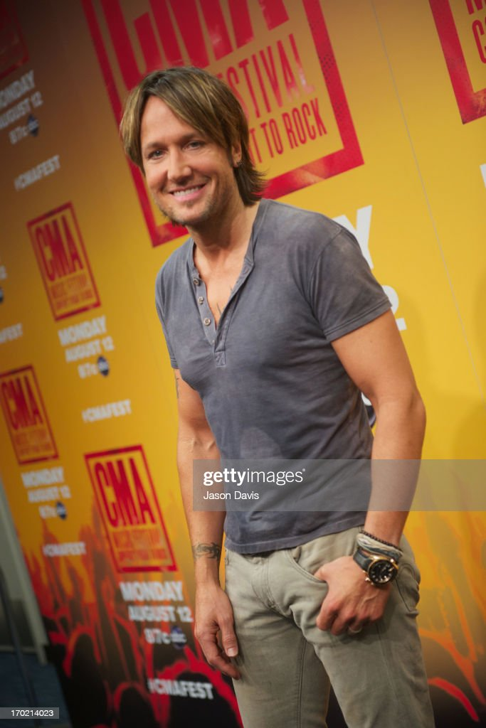 <a gi-track='captionPersonalityLinkClicked' href=/galleries/search?phrase=Keith+Urban&family=editorial&specificpeople=202997 ng-click='$event.stopPropagation()'>Keith Urban</a> speaks at a press conference at the 2013 CMA Music Festival on June 8, 2013 in Nashville, Tennessee.