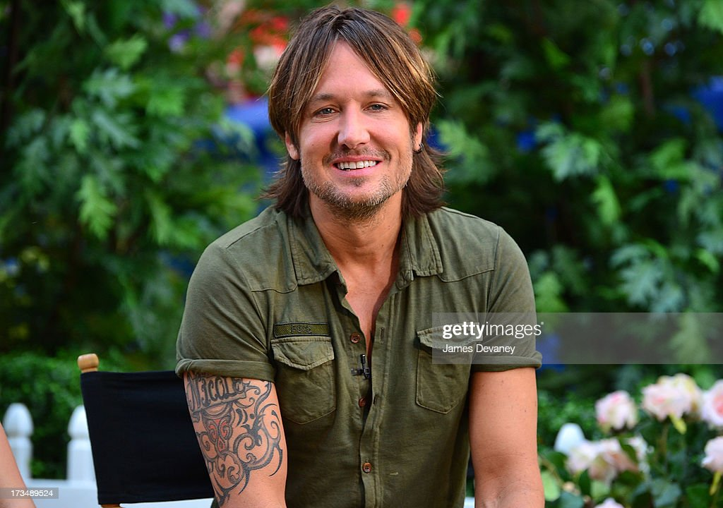 <a gi-track='captionPersonalityLinkClicked' href=/galleries/search?phrase=Keith+Urban&family=editorial&specificpeople=202997 ng-click='$event.stopPropagation()'>Keith Urban</a> visits ABC's 'Good Morning America' on July 15, 2013 in New York, United States.
