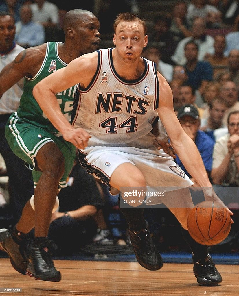 Keith Van Horn R of the New Jersey Nets dribbles