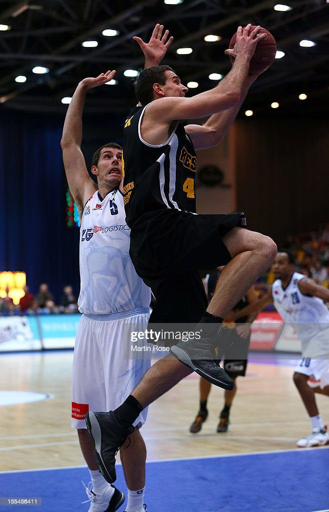 Keith Waleszkowski (L) of Bremerhaven challenges for the ball with John Turek (R) of Ludwigsburg during the Beko BBL basketball match between Eisbaeren Bremerhaven and Nackar RIESEN Ludwigsburg at the Stadthalle on November 4, 2012 in Bremerhaven, Germany.