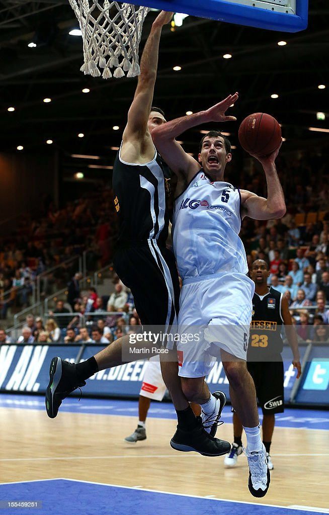 Keith Waleszkowski (R) of Bremerhaven challenges for the ball with John Turek (L) of Ludwigsburg during the Beko BBL basketball match between Eisbaeren Bremerhaven and Nackar RIESEN Ludwigsburg at the Stadthalle on November 4, 2012 in Bremerhaven, Germany.