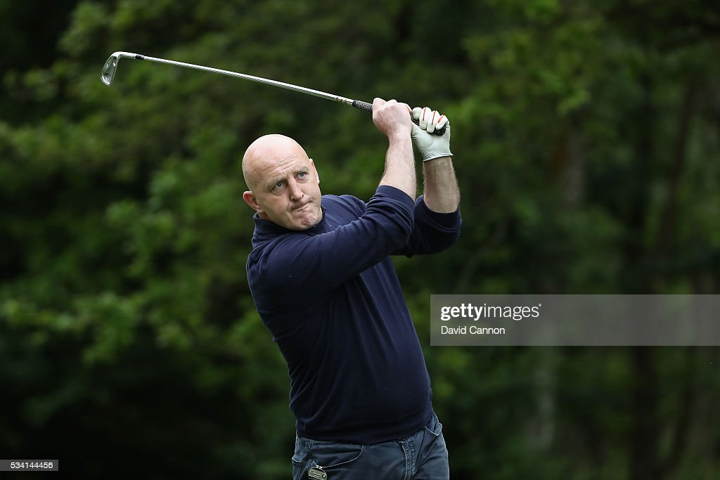 <a gi-track='captionPersonalityLinkClicked' href=/galleries/search?phrase=Keith+Wood&family=editorial&specificpeople=855185 ng-click='$event.stopPropagation()'>Keith Wood</a> tees off during the Pro-Am prior to the BMW PGA Championship at Wentworth on May 25, 2016 in Virginia Water, England.