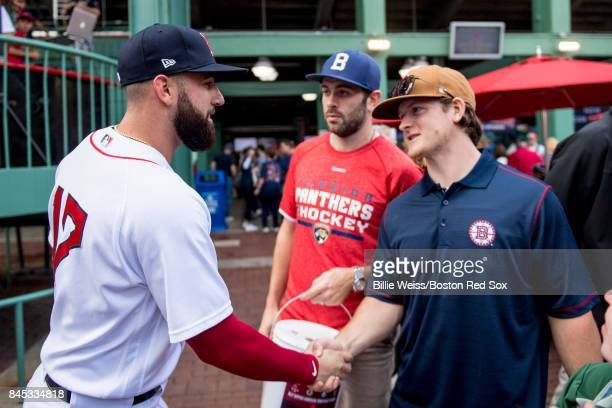 Keith Yandel of the Florida Panthers and Torey Krug of the Boston Bruins meet Deven Marrero of the Boston Red Sox as they collect money at the gates...
