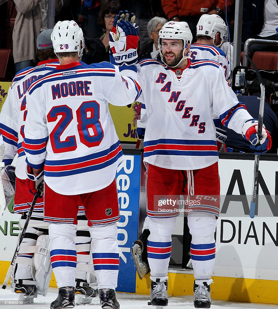 Keith Yandle #93 and Dominic Moore #28 of the New York Rangers high-five each other after the Rangers' 2-1 win against the Anaheim Ducks on March 16, 2016 at Honda Center in Anaheim, California.