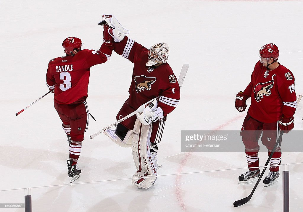 <a gi-track='captionPersonalityLinkClicked' href=/galleries/search?phrase=Keith+Yandle&family=editorial&specificpeople=606912 ng-click='$event.stopPropagation()'>Keith Yandle</a> #3 and goaltender Jason LaBarbera #1 of the Phoenix Coyotes high-five after defeating the Columbus Blue Jackets in the NHL game at Jobing.com Arena on January 23, 2013 in Glendale, Arizona. The Coyotes defeated the Blue Jackets 5-1.