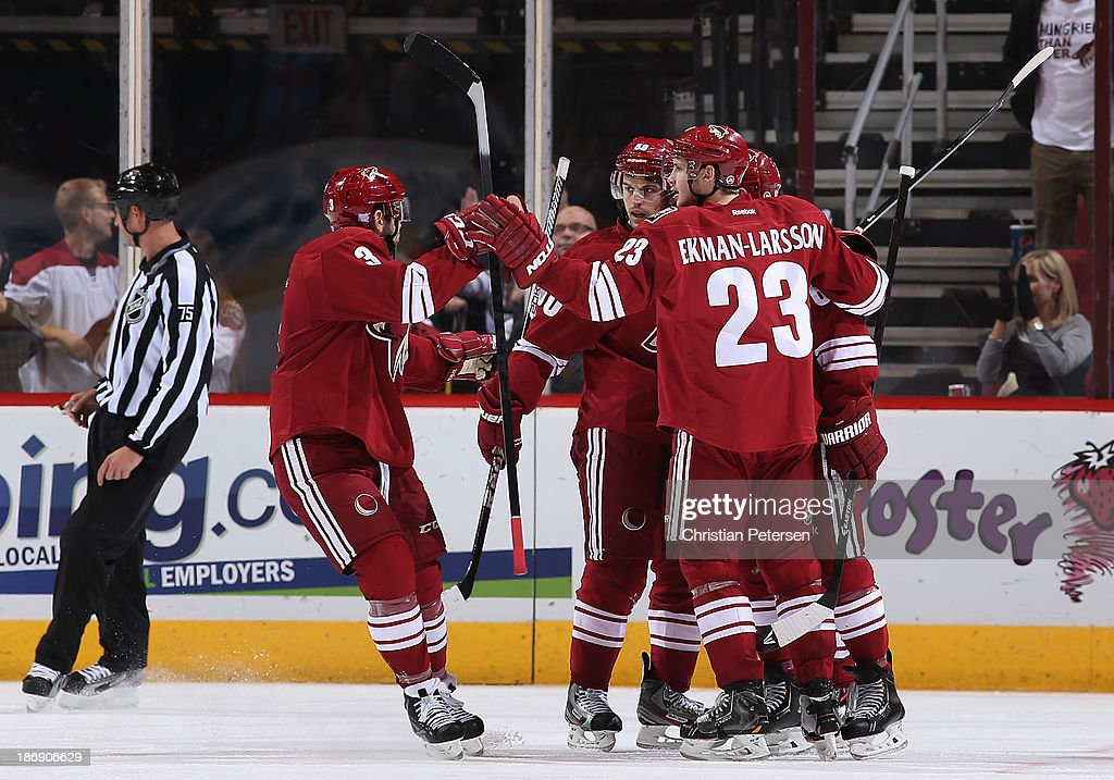 <a gi-track='captionPersonalityLinkClicked' href=/galleries/search?phrase=Keith+Yandle&family=editorial&specificpeople=606912 ng-click='$event.stopPropagation()'>Keith Yandle</a> #3, <a gi-track='captionPersonalityLinkClicked' href=/galleries/search?phrase=Antoine+Vermette&family=editorial&specificpeople=206302 ng-click='$event.stopPropagation()'>Antoine Vermette</a> #50 and <a gi-track='captionPersonalityLinkClicked' href=/galleries/search?phrase=Oliver+Ekman-Larsson&family=editorial&specificpeople=5894618 ng-click='$event.stopPropagation()'>Oliver Ekman-Larsson</a> #23 of the Phoenix Coyotes celebrate after scoring against the Nashville Predators during the NHL game at Jobing.com Arena on October 31, 2013 in Glendale, Arizona. The Coyotes defeated the Predators 5-4 in an overtime shoot out.