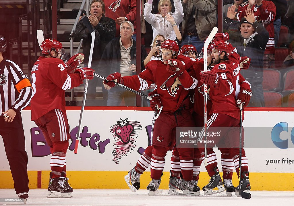 Keith Yandle #3, Antoine Vermette #50, Matthew Lombardi #8, Shane Doan #19 and David Schlemko #6 of the Phoenix Coyotes celebrate after scoring against the Chicago Blackhawks during the NHL game at Jobing.com Arena on January 20, 2013 in Glendale, Arizona. The Blackhawks defeated the Coyotes 6-4.