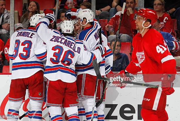 Keith Yandle Mats Zuccarello and JT Miller of the New York Rangers celebrates a third period goal by Chris Kreider next to Luke Glendening of the...