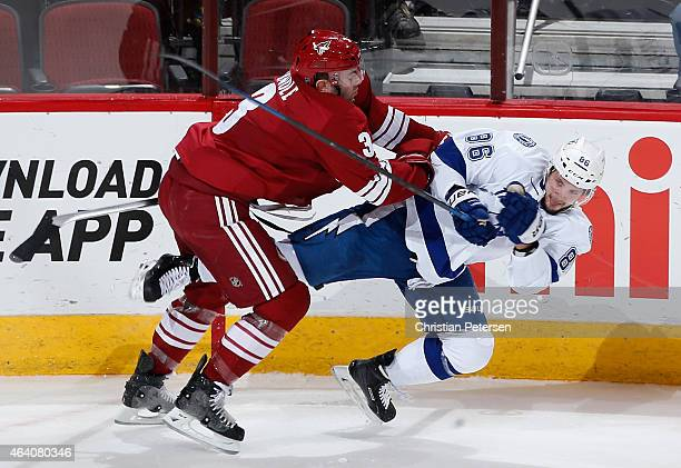 Keith Yandle of the Arizona Coyotes checks Nikita Kucherov of the Tampa Bay Lightning during the first period of the NHL game at Gila River Arena on...