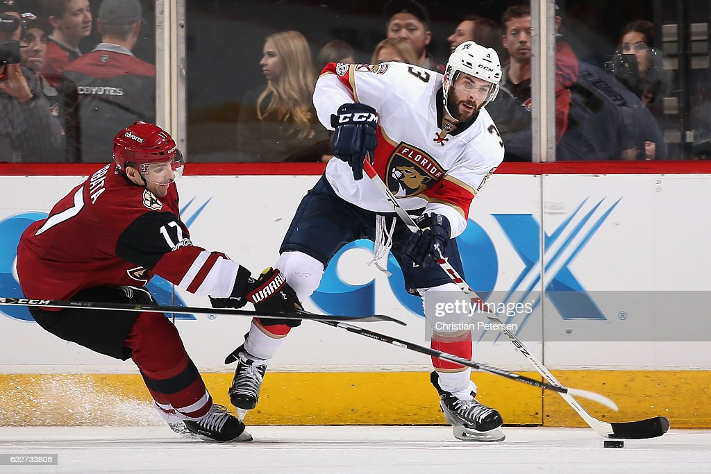 Keith Yandle #3 of the Florida Panthers looks to pass against Radim Vrbata #17 of the Arizona Coyotes during the third period of the NHL game at Gila River Arena on January 23, 2017 in Glendale, Arizona. The Coyotes defeated the Panthers 3-2 in overtime.