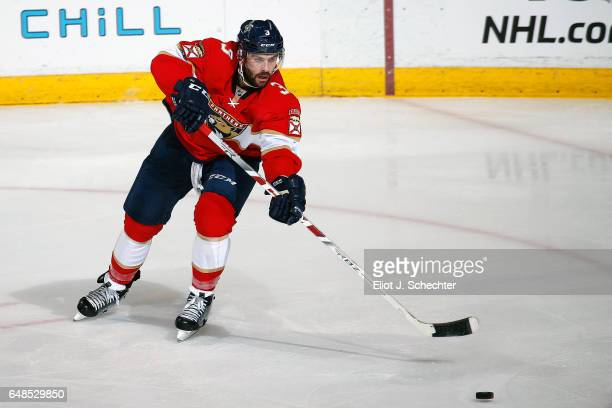 Keith Yandle of the Florida Panthers passes the puck against the Dallas Stars at the BBT Center on March 4 2017 in Sunrise Florida