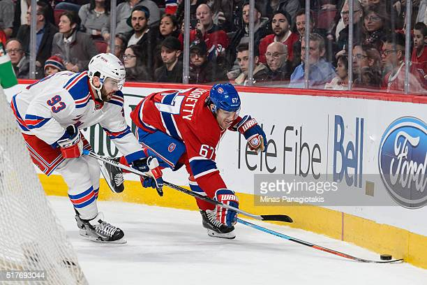 Keith Yandle of the New York Rangers and Max Pacioretty of the Montreal Canadiens chase the puck near the boards during the NHL game at the Bell...