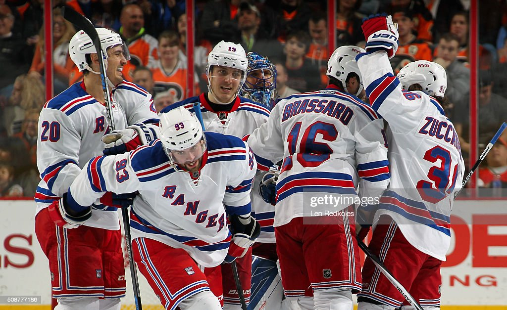 <a gi-track='captionPersonalityLinkClicked' href=/galleries/search?phrase=Keith+Yandle&family=editorial&specificpeople=606912 ng-click='$event.stopPropagation()'>Keith Yandle</a> #93 of the New York Rangers celebrates his game-tying goal late in third period against the Philadelphia Flyers with teammates <a gi-track='captionPersonalityLinkClicked' href=/galleries/search?phrase=Chris+Kreider&family=editorial&specificpeople=5894671 ng-click='$event.stopPropagation()'>Chris Kreider</a> #20, <a gi-track='captionPersonalityLinkClicked' href=/galleries/search?phrase=Kevin+Hayes+-+Ice+Hockey+Player&family=editorial&specificpeople=13635523 ng-click='$event.stopPropagation()'>Kevin Hayes</a> #13, <a gi-track='captionPersonalityLinkClicked' href=/galleries/search?phrase=Henrik+Lundqvist&family=editorial&specificpeople=217958 ng-click='$event.stopPropagation()'>Henrik Lundqvist</a> #30, <a gi-track='captionPersonalityLinkClicked' href=/galleries/search?phrase=Derick+Brassard&family=editorial&specificpeople=540468 ng-click='$event.stopPropagation()'>Derick Brassard</a> #16, and <a gi-track='captionPersonalityLinkClicked' href=/galleries/search?phrase=Mats+Zuccarello&family=editorial&specificpeople=7219903 ng-click='$event.stopPropagation()'>Mats Zuccarello</a> #36 on February 6, 2016 at the Wells Fargo Center in Philadelphia, Pennsylvania. The Rangers went on to defeat the Flyers 3-2 in a shootout.