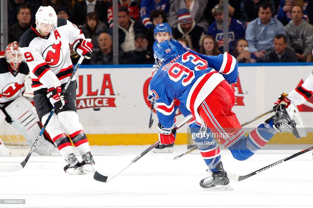 <a gi-track='captionPersonalityLinkClicked' href=/galleries/search?phrase=Keith+Yandle&family=editorial&specificpeople=606912 ng-click='$event.stopPropagation()'>Keith Yandle</a> #93 of the New York Rangers shoots the puck against Corey Schneider #35 of the New Jersey Devils as <a gi-track='captionPersonalityLinkClicked' href=/galleries/search?phrase=Travis+Zajac&family=editorial&specificpeople=864182 ng-click='$event.stopPropagation()'>Travis Zajac</a> #19 attempts to block the shot at Madison Square Garden on February 8, 2016 in New York City.