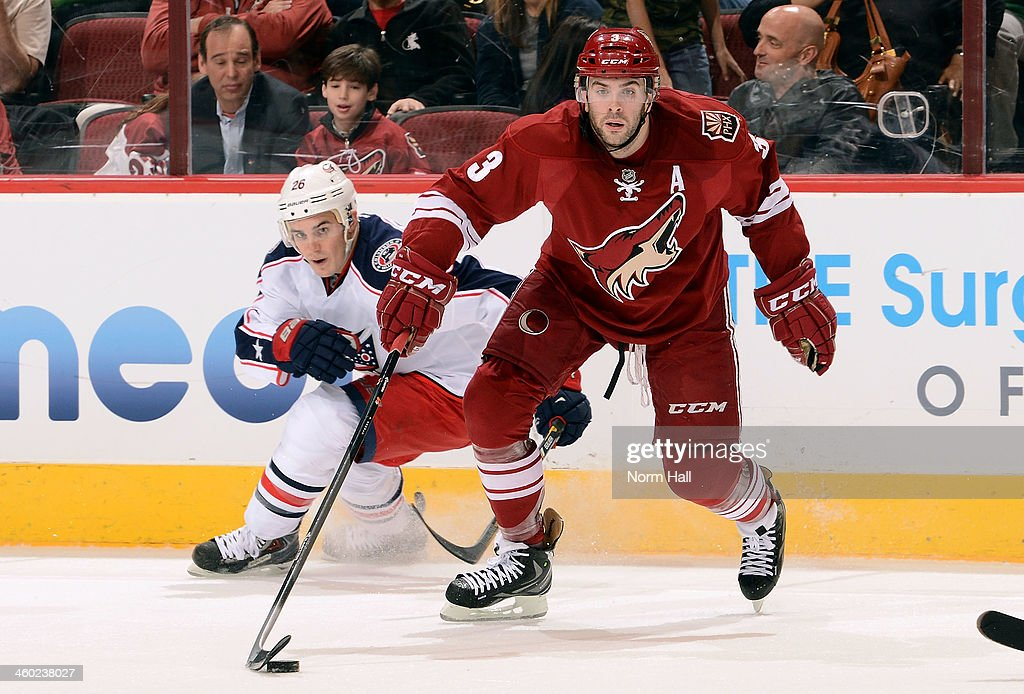 <a gi-track='captionPersonalityLinkClicked' href=/galleries/search?phrase=Keith+Yandle&family=editorial&specificpeople=606912 ng-click='$event.stopPropagation()'>Keith Yandle</a> #3 of the Phoenix Coyotes advance the puck as <a gi-track='captionPersonalityLinkClicked' href=/galleries/search?phrase=Corey+Tropp&family=editorial&specificpeople=5483748 ng-click='$event.stopPropagation()'>Corey Tropp</a> # 26 of the Columbus Blue Jackets defends during the second period at Jobing.com Arena on January 2, 2014 in Glendale, Arizona.