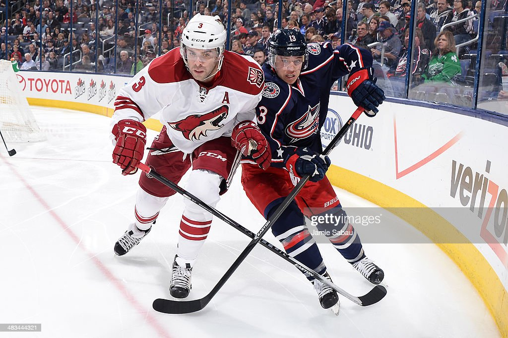 <a gi-track='captionPersonalityLinkClicked' href=/galleries/search?phrase=Keith+Yandle&family=editorial&specificpeople=606912 ng-click='$event.stopPropagation()'>Keith Yandle</a> #3 of the Phoenix Coyotes and <a gi-track='captionPersonalityLinkClicked' href=/galleries/search?phrase=Cam+Atkinson&family=editorial&specificpeople=6270272 ng-click='$event.stopPropagation()'>Cam Atkinson</a> #13 of the Columbus Blue Jackets battle as they skate after the puck during the third period on April 8, 2014 at Nationwide Arena in Columbus, Ohio. Columbus defeated Phoenix 4-3 in overtime.