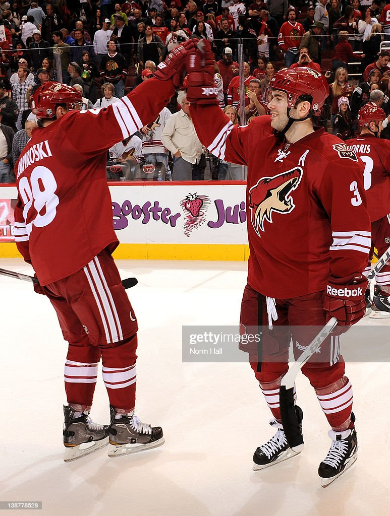a11881c5b ... Keith Yandle 3 of the Phoenix Coyotes celebrates with teammate Lauri  Korpikoski 28 after Mens Arizona Coyotes Customized Jersey ...