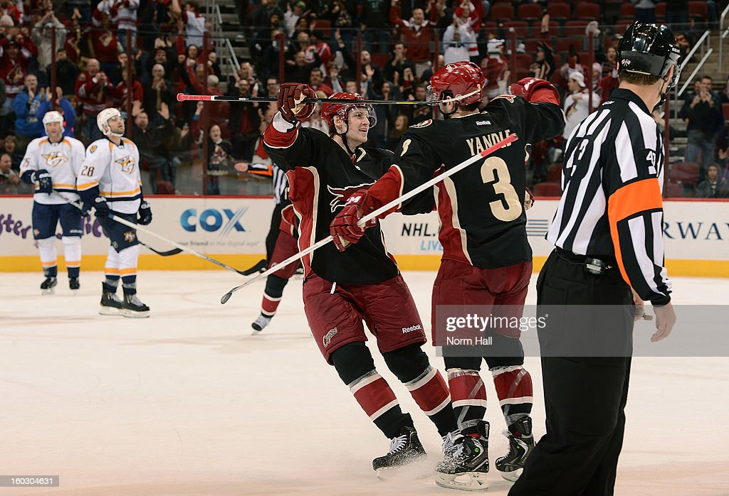 Keith Yandle #3 of the Phoenix Coyotes celebrates with teammate Oliver Ekman-Larsson #23 after his third period goal against the Nashville Predators at Jobing.com Arena on January 28, 2013 in Glendale, Arizona.