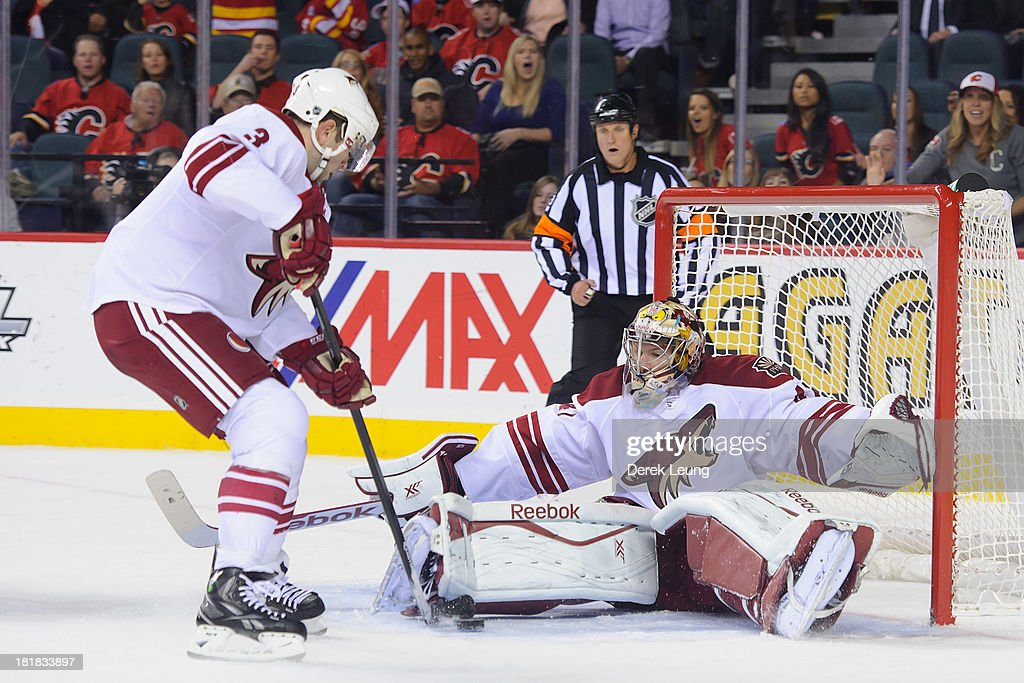 <a gi-track='captionPersonalityLinkClicked' href=/galleries/search?phrase=Keith+Yandle&family=editorial&specificpeople=606912 ng-click='$event.stopPropagation()'>Keith Yandle</a> #3 of the Phoenix Coyotes helps his goalie Mike Smith #41 clear the puck during a preseason NHL game against the Calgary Flames at Scotiabank Saddledome on September 25, 2013 in Calgary, Alberta, Canada.