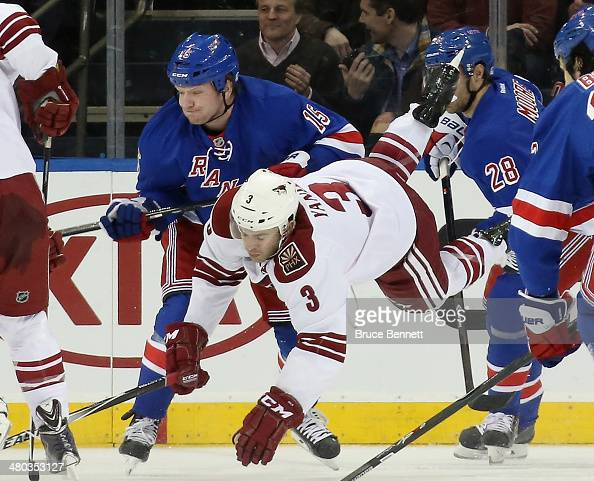 Keith Yandle of the Phoenix Coyotes is tripped up by Derek Dorsett of the New York Rangers during the first period at Madison Square Garden on March...