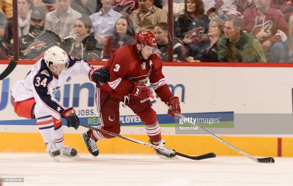 <a gi-track='captionPersonalityLinkClicked' href=/galleries/search?phrase=Keith+Yandle&family=editorial&specificpeople=606912 ng-click='$event.stopPropagation()'>Keith Yandle</a> #3 of the Phoenix Coyotes skates the puck past Nick Drazenovic #34 of the Columbus Blue Jackets during the second period at Jobing.com Arena on February 16, 2013 in Glendale, Arizona.