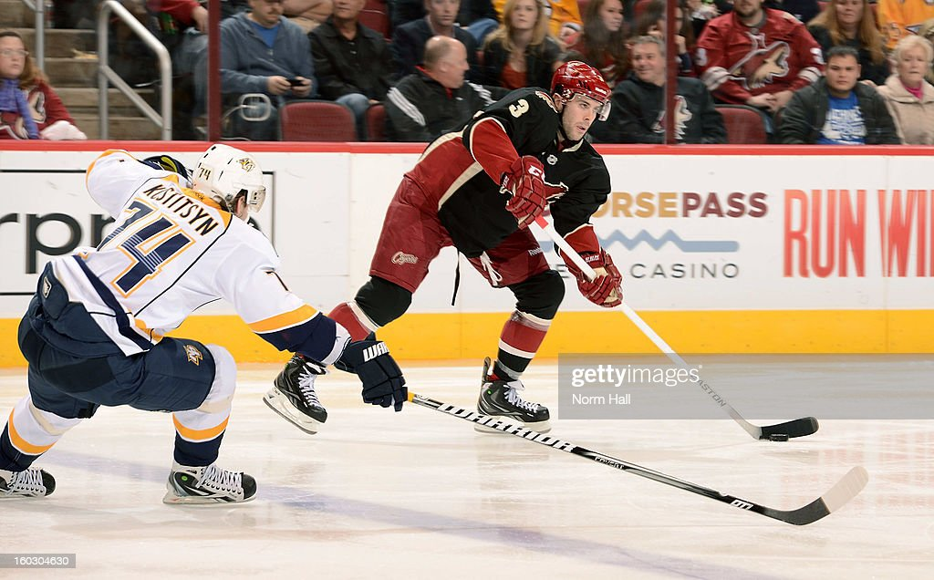 Keith Yandle #3 of the Phoenix Coyotes skates the puck up ice past Sergei Kostitsyn #74 of the Nashville Predators at Jobing.com Arena on January 28, 2013 in Glendale, Arizona.