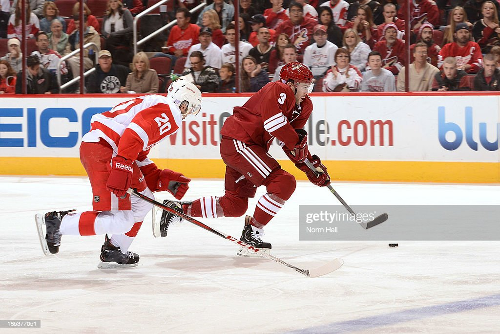 <a gi-track='captionPersonalityLinkClicked' href=/galleries/search?phrase=Keith+Yandle&family=editorial&specificpeople=606912 ng-click='$event.stopPropagation()'>Keith Yandle</a> #3 of the Phoenix Coyotes skates up ice with the puck while being chased by Drew Miller #20 of the Detroit Red Wings at Jobing.com Arena on October 19, 2013 in Glendale, Arizona.