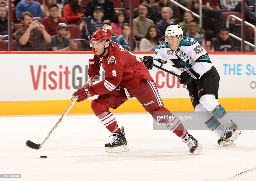 <a gi-track='captionPersonalityLinkClicked' href=/galleries/search?phrase=Keith+Yandle&family=editorial&specificpeople=606912 ng-click='$event.stopPropagation()'>Keith Yandle</a> #3 of the Phoenix Coyotes skates with the puck as <a gi-track='captionPersonalityLinkClicked' href=/galleries/search?phrase=Tommy+Wingels&family=editorial&specificpeople=5807738 ng-click='$event.stopPropagation()'>Tommy Wingels</a> #57 of the San Jose Sharks defends during the third period at Jobing.com Arena on April 24, 2013 in Glendale, Arizona.
