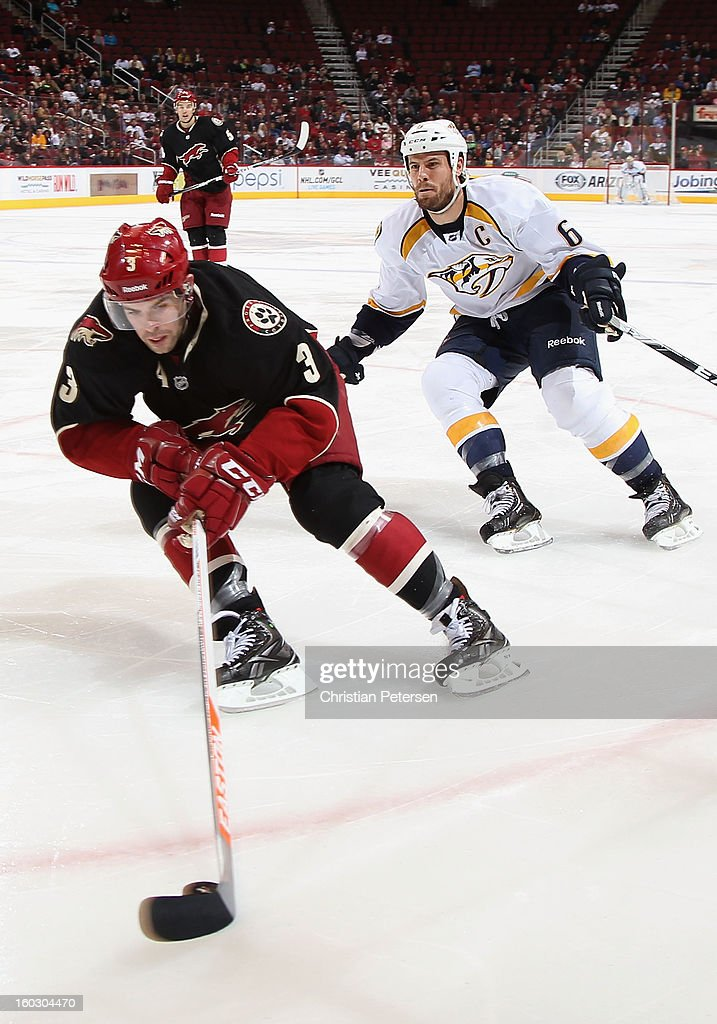 <a gi-track='captionPersonalityLinkClicked' href=/galleries/search?phrase=Keith+Yandle&family=editorial&specificpeople=606912 ng-click='$event.stopPropagation()'>Keith Yandle</a> #3 of the Phoenix Coyotes skates with the puck past <a gi-track='captionPersonalityLinkClicked' href=/galleries/search?phrase=Shea+Weber&family=editorial&specificpeople=554412 ng-click='$event.stopPropagation()'>Shea Weber</a> #6 of the Nashville Predators during the NHL game at Jobing.com Arena on January 28, 2013 in Glendale, Arizona. The Coyotes defeated the Predators 4-0.