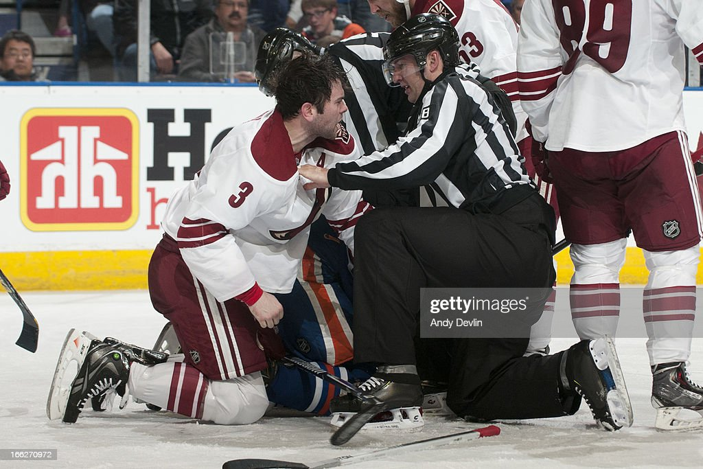 <a gi-track='captionPersonalityLinkClicked' href=/galleries/search?phrase=Keith+Yandle&family=editorial&specificpeople=606912 ng-click='$event.stopPropagation()'>Keith Yandle</a> #3 of the Phoenix Coyotes voices his displeasure after being cross-checked in a game against the Edmonton Oilers on April 10, 2013 at Rexall Place in Edmonton, Alberta, Canada.
