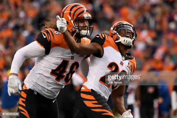 KeiVarae Russell and Clark Harris of the Cincinnati Bengals celebrate a blocked kick during the second quarter against the Denver Broncos The Denver...
